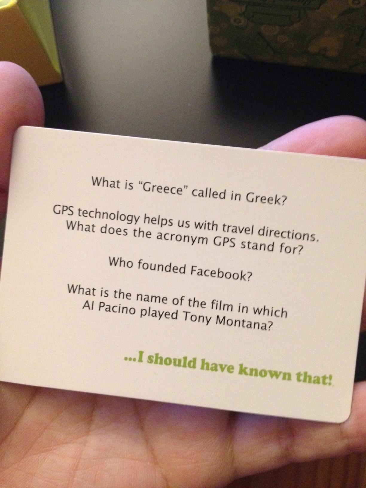 "Reviewer photo of a game card that has questions like, ""Who founded Facebook?"" and ""What is 'Greece' called in Greek"""