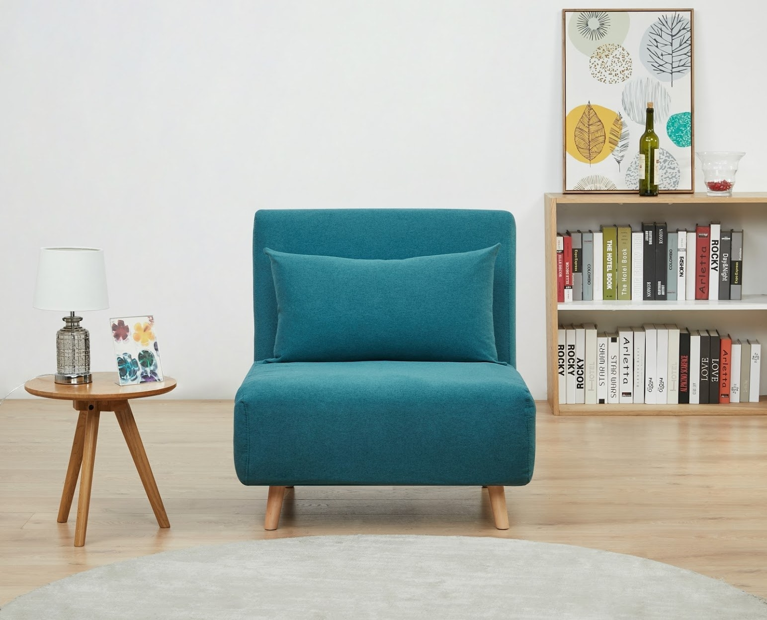 the blue accent chair with wooden legs