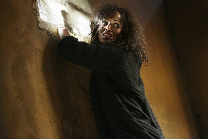 Kerry Washington as Olivia Pope trying to escape through a window after being captured