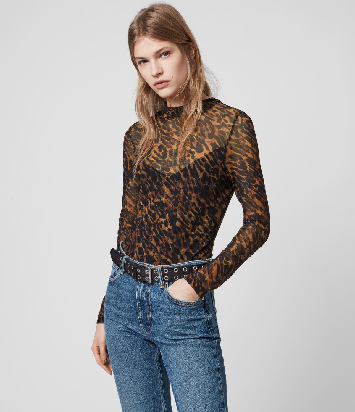 model wearing a cheetah print sheer bodysuit over a cami and tucked into jeans