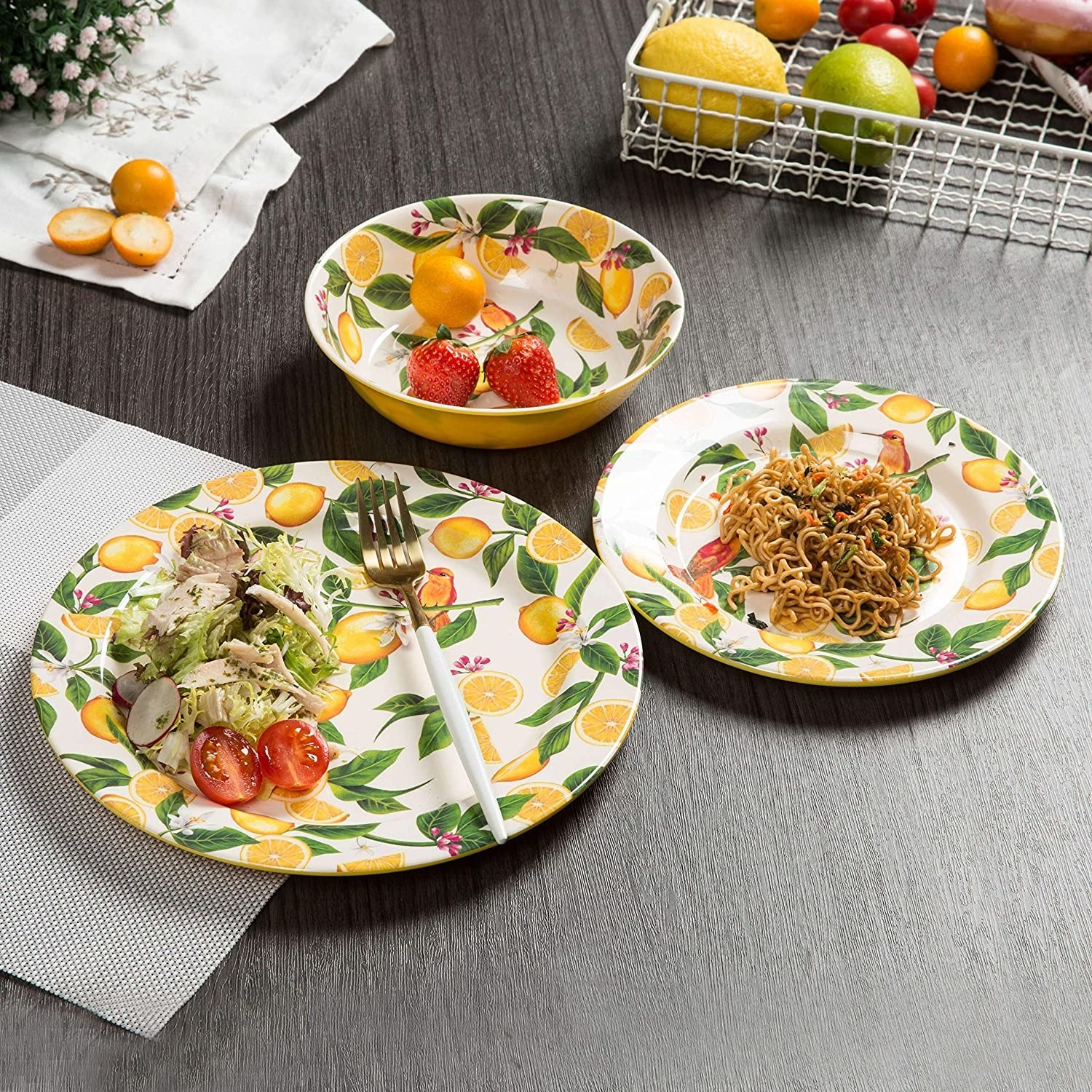 a large plate, small plate, and bowl set with an all-over lemon print