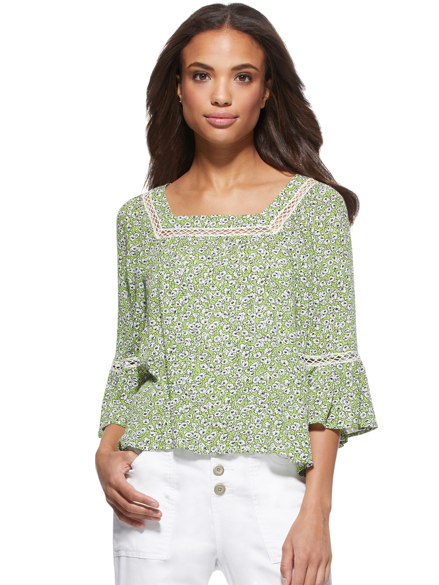 The green and white floral blouse