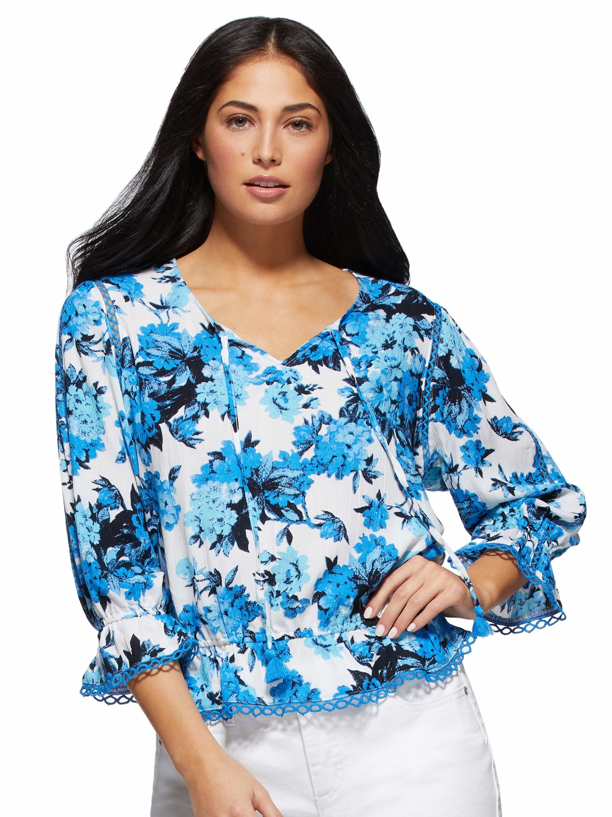 The bright blue floral blouse with eyelet hem