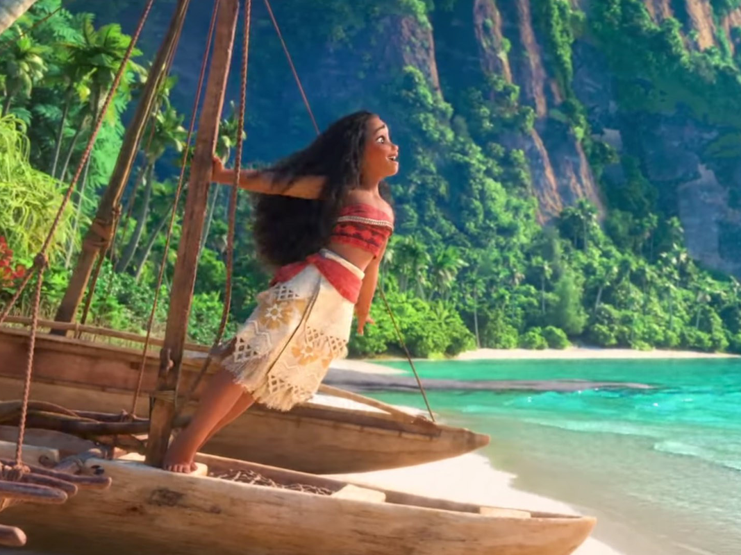 Moana in her skirt and top outfit on the beach