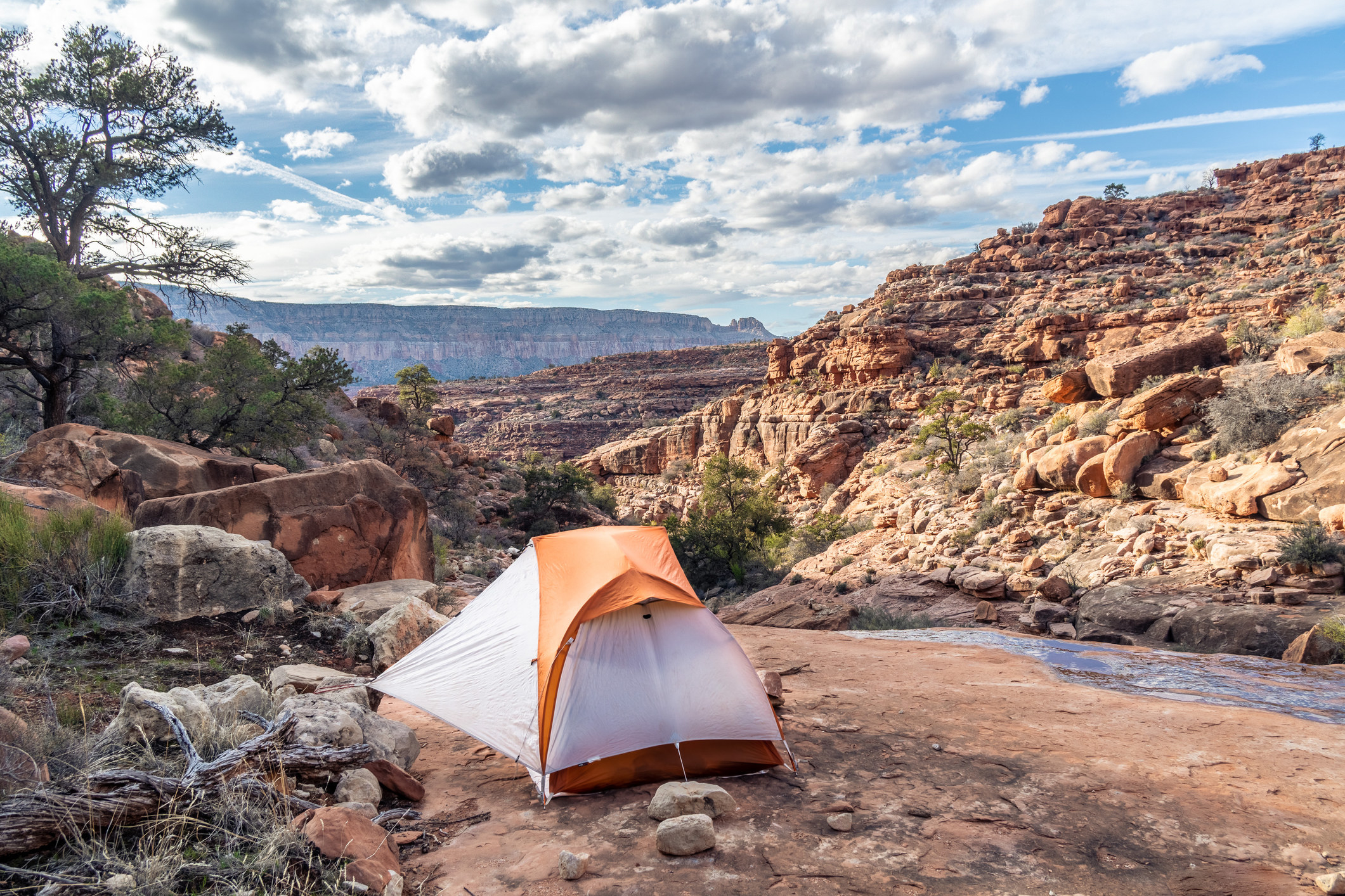 Camping on a platform of rock in the Royal Arch Drainage with running water nearby — Grand Canyon National Park, Arizona