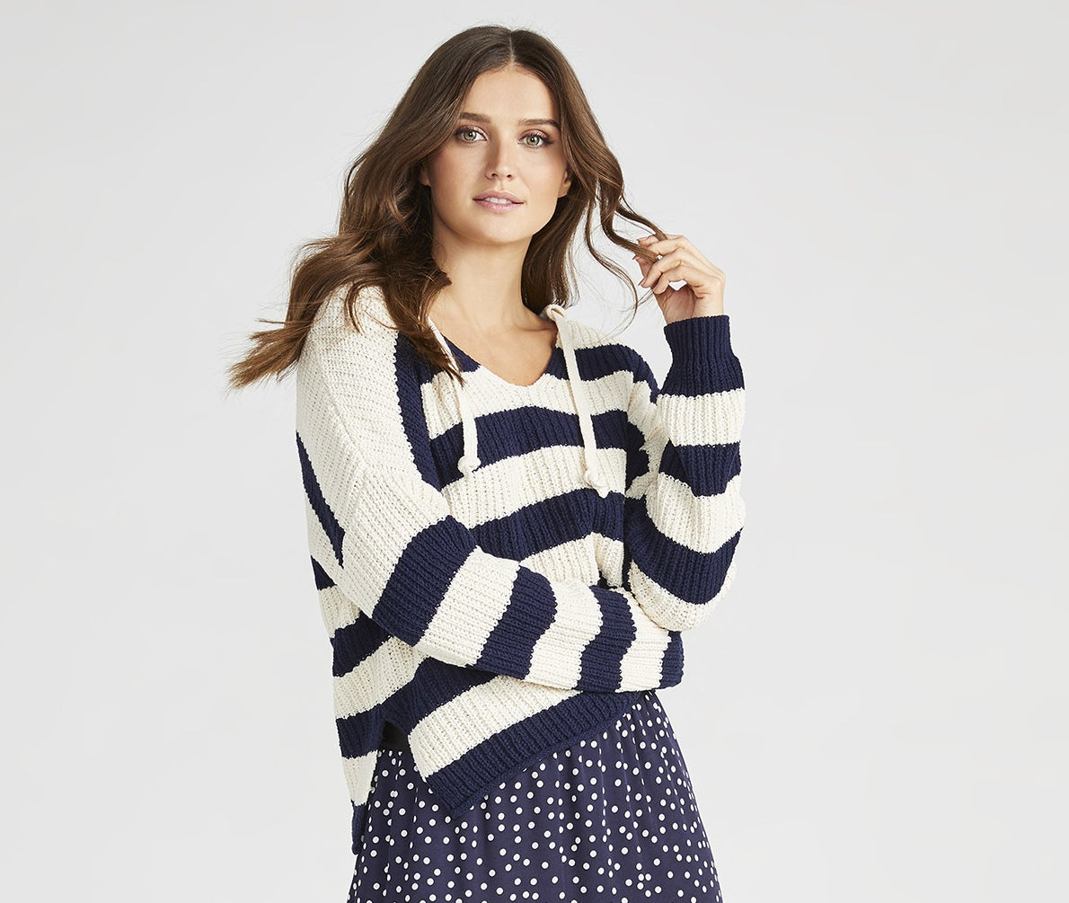 Model wearing the white and navy striped sweater