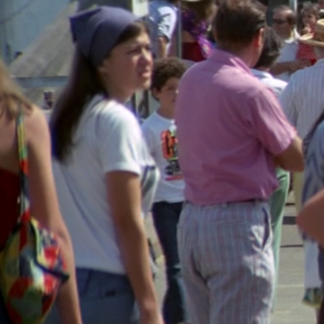 A still from the movie Jaws – a woman in a crowd wearing a blue bandanna and jeans