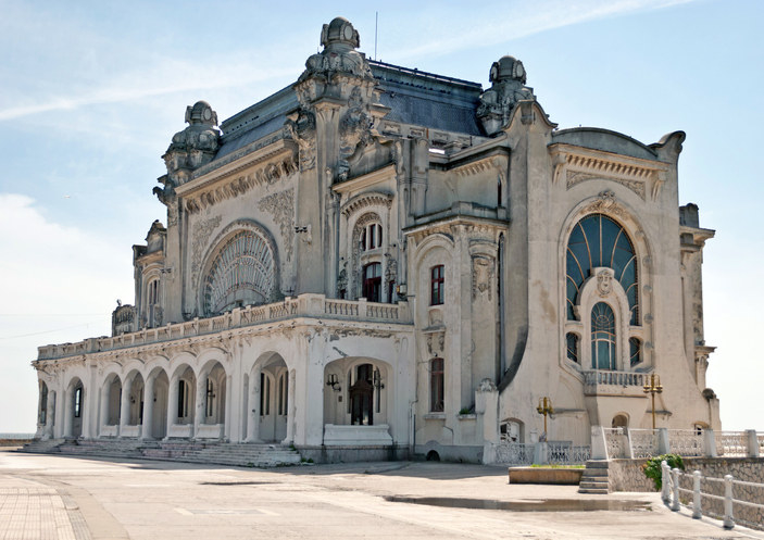 Abandoned seaside casino located in Romania, beautiful art-deco building in white stone with large glass windows