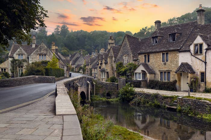 A bridge covers the Bybrook river in the village of Castle Combe in Wiltshire