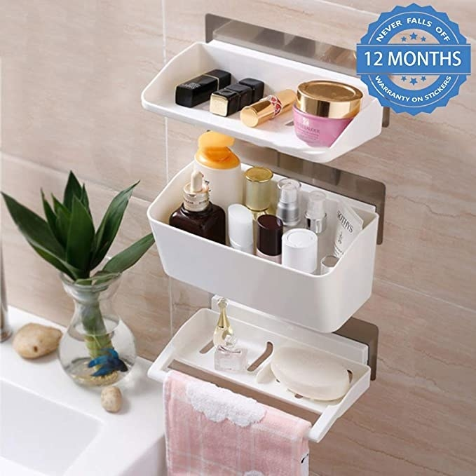 Wall bathroom organiser with soap, skincare products and a face towel on it.