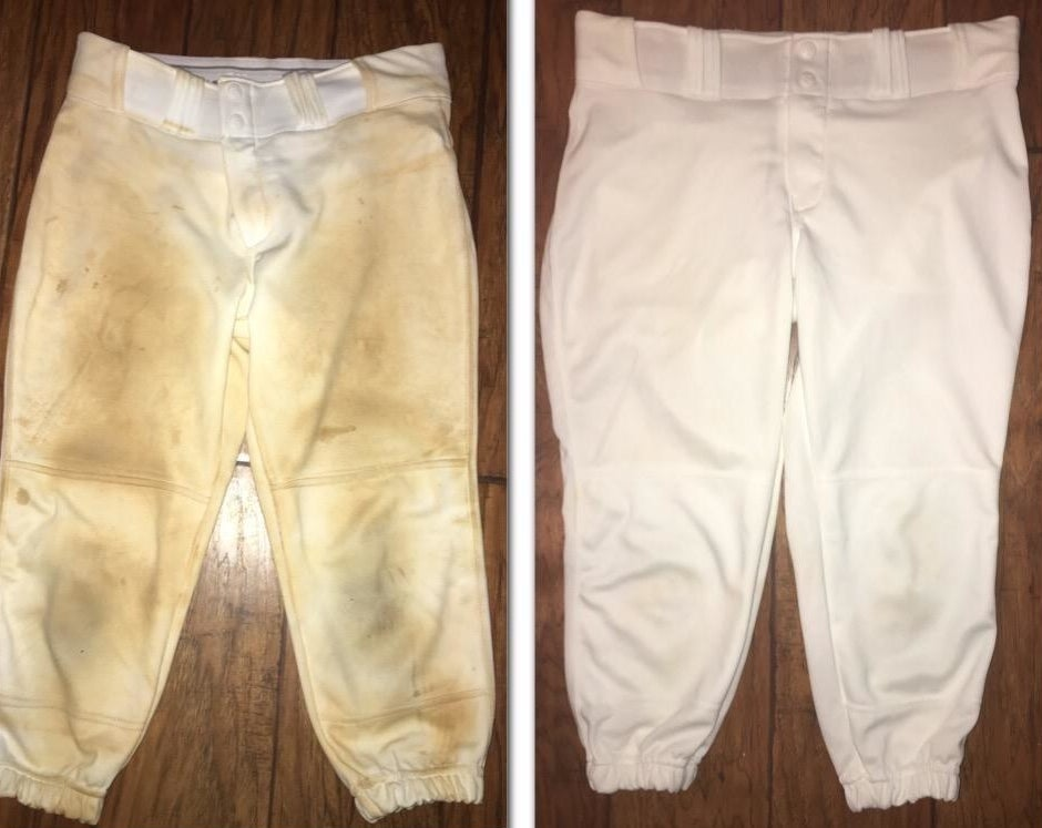 Reviewer before-and-after photos showing a pair of dirty white sweatpants completely washed clean using the soap bar