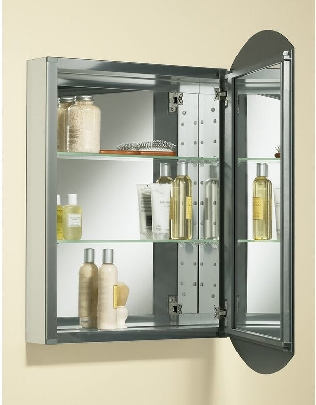 A mirrored metal medicine cabinet with interior mirrors and three shevles
