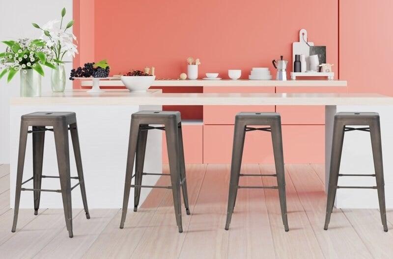 Four gunmetal-colored bar stools