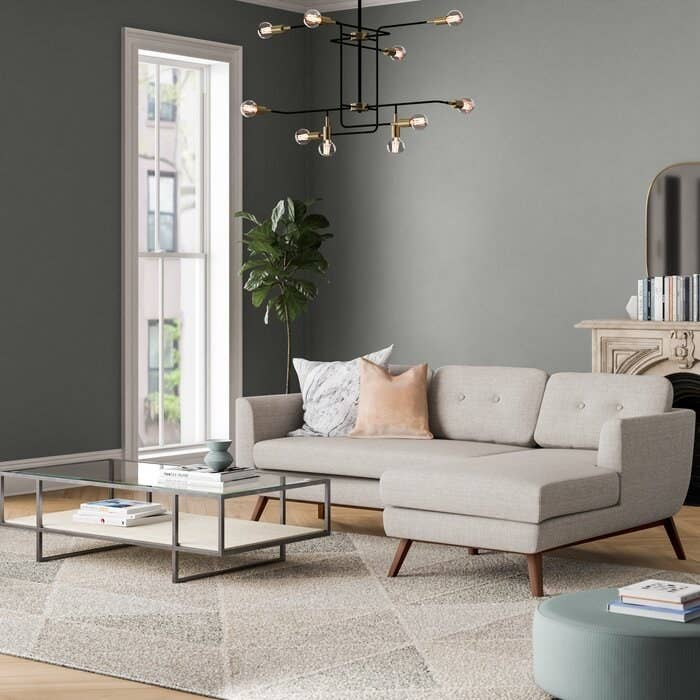 Sectional in venga mole light gray with tufted cushions and wooden mid-century style legs
