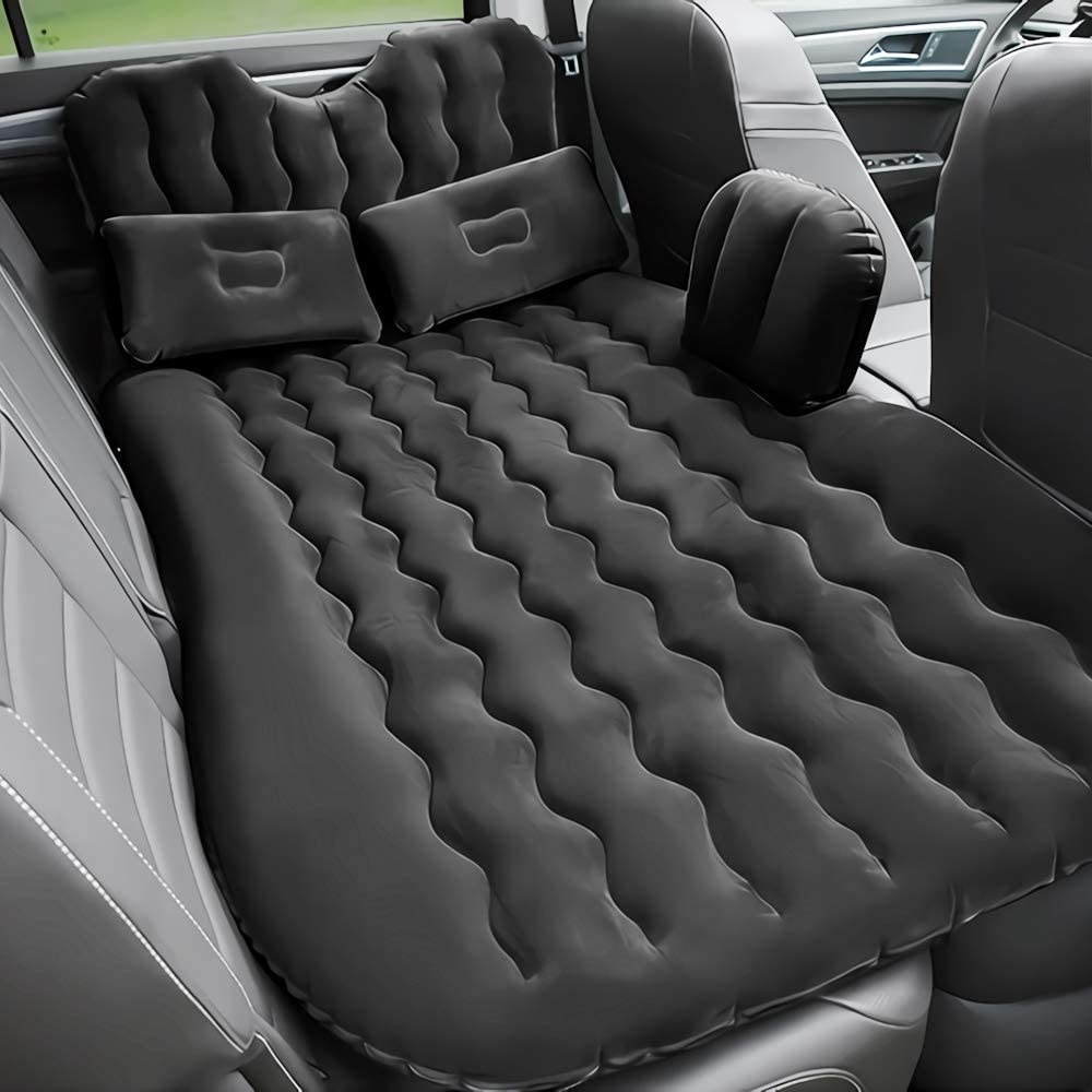 The air mattress laid out in a car back seat