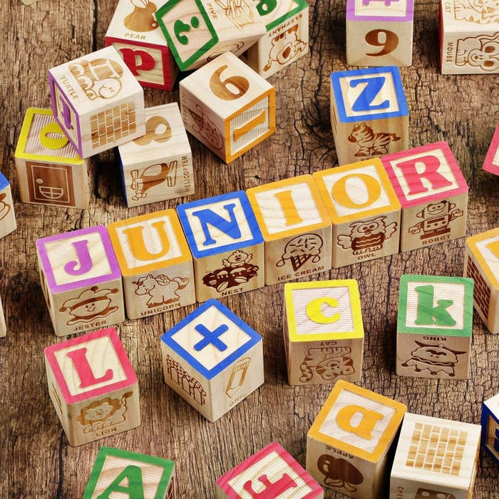 wooden square blocks with different animals and letters on them