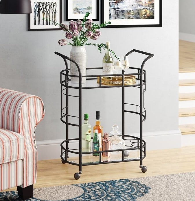 A hammered bronze two-level bar cart