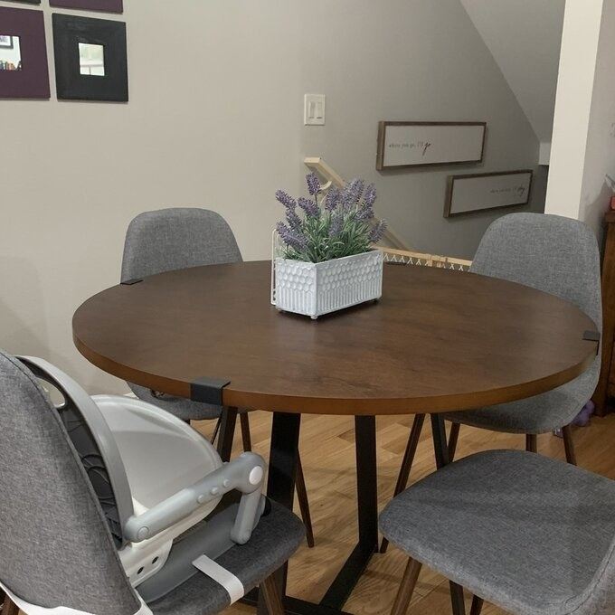 A reviewer's photo of an oval dark wood dining table