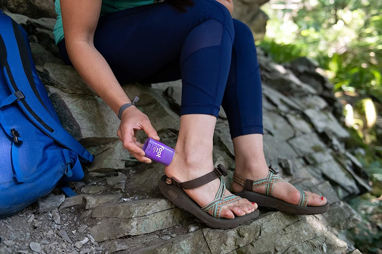 Model applying balm to the heel area