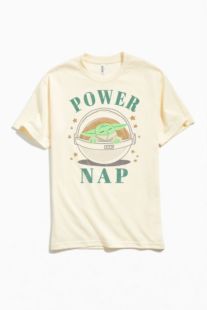 "A T-shirt with The Child sleeping inside a travel pod and the words ""power nap"" around him"