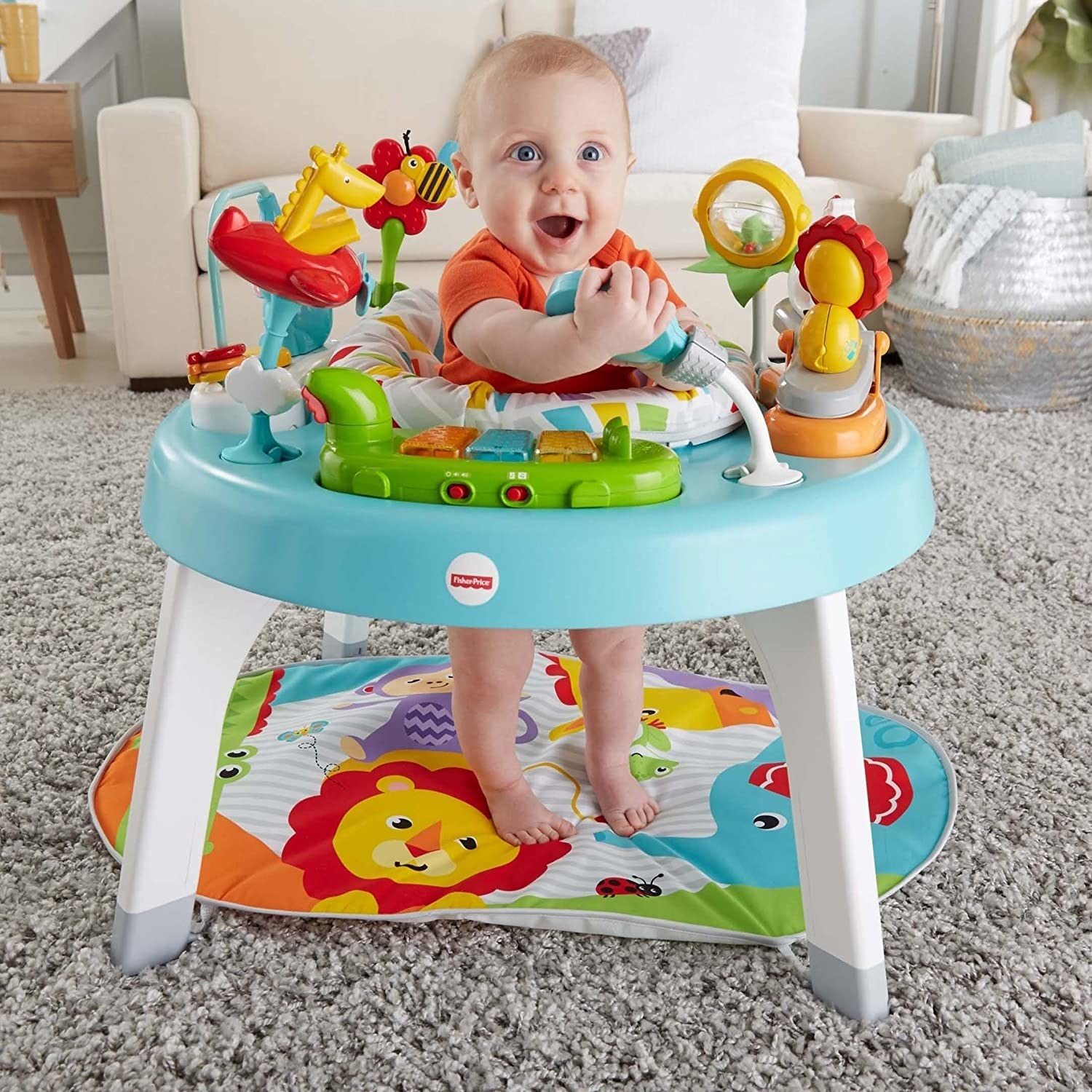 a baby standing inside the play center surrounded by toys