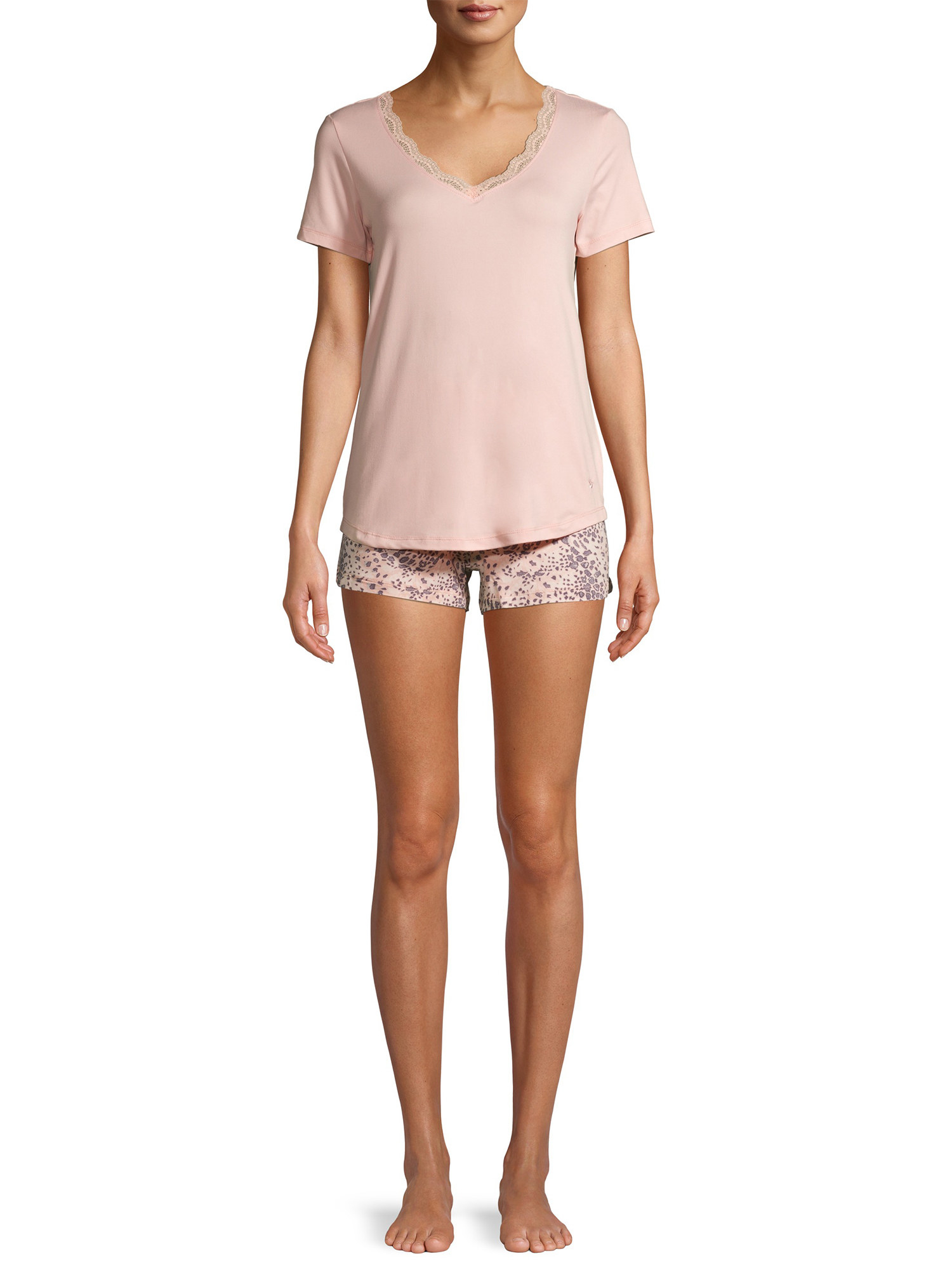 A model in pink t-shirt and pink patterned shorts