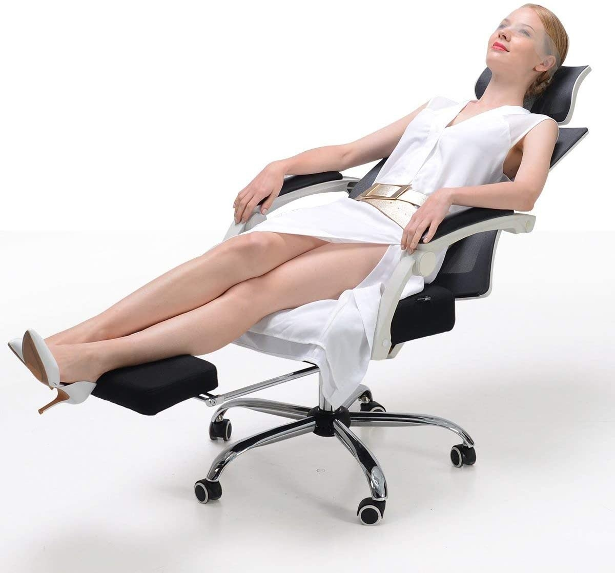 A model sleeping in reclining desk chair that also has a place to prop feet up