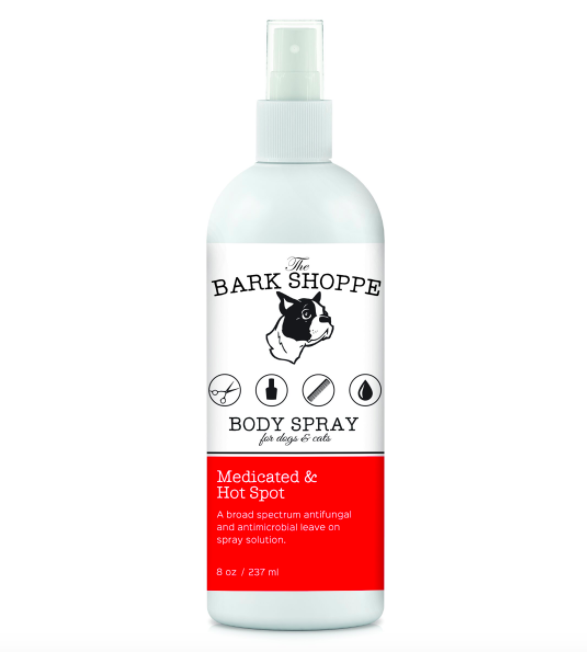 """White spray bottle that says """"The Bark Shoppe Medicated & Hot Spot Body Spray for dogs and cats"""""""