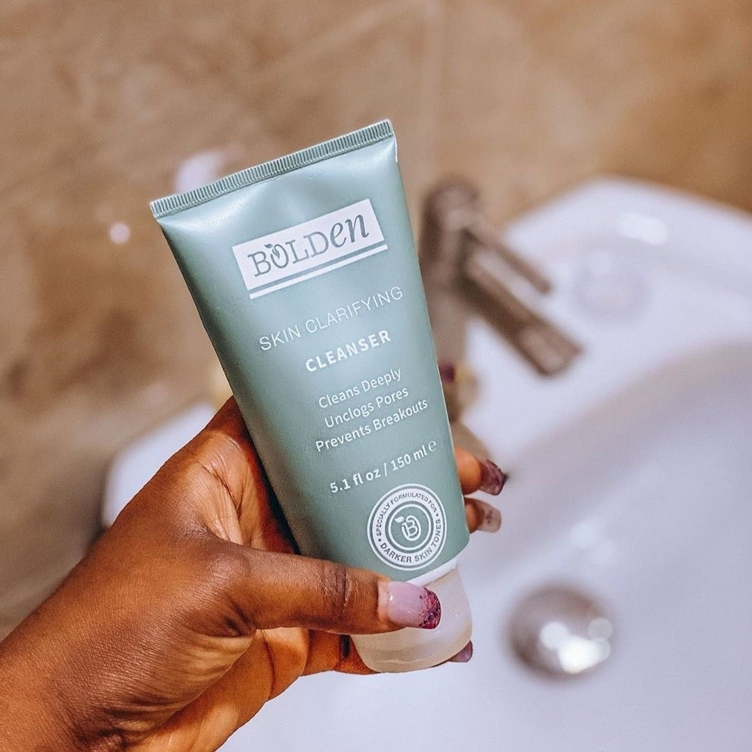 Hand holding the facial cleanser