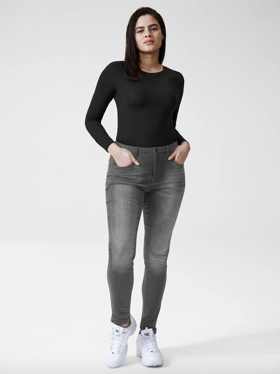 Model wearing the jeans in gray