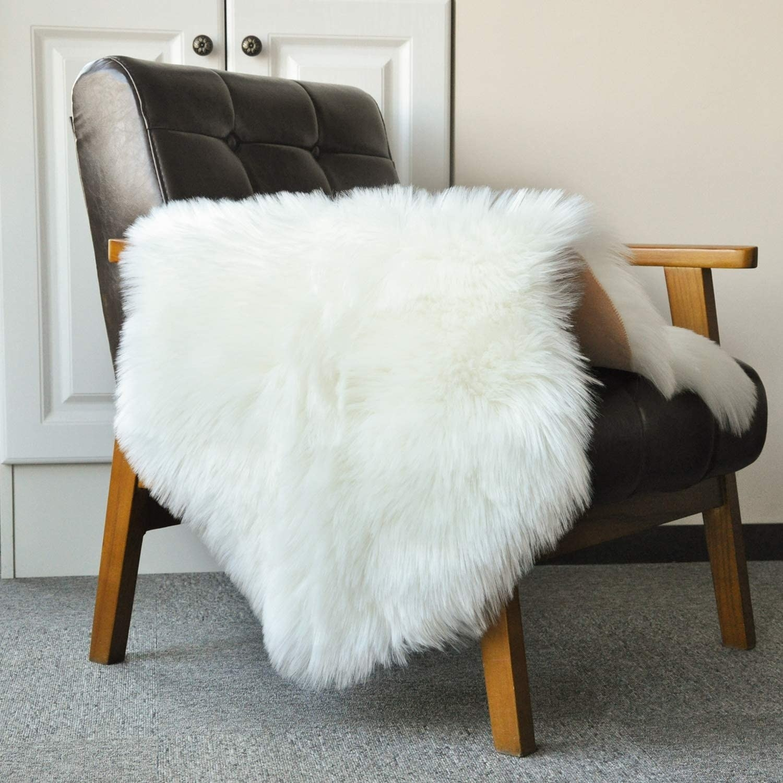 A faux sheepskin rug on a chair
