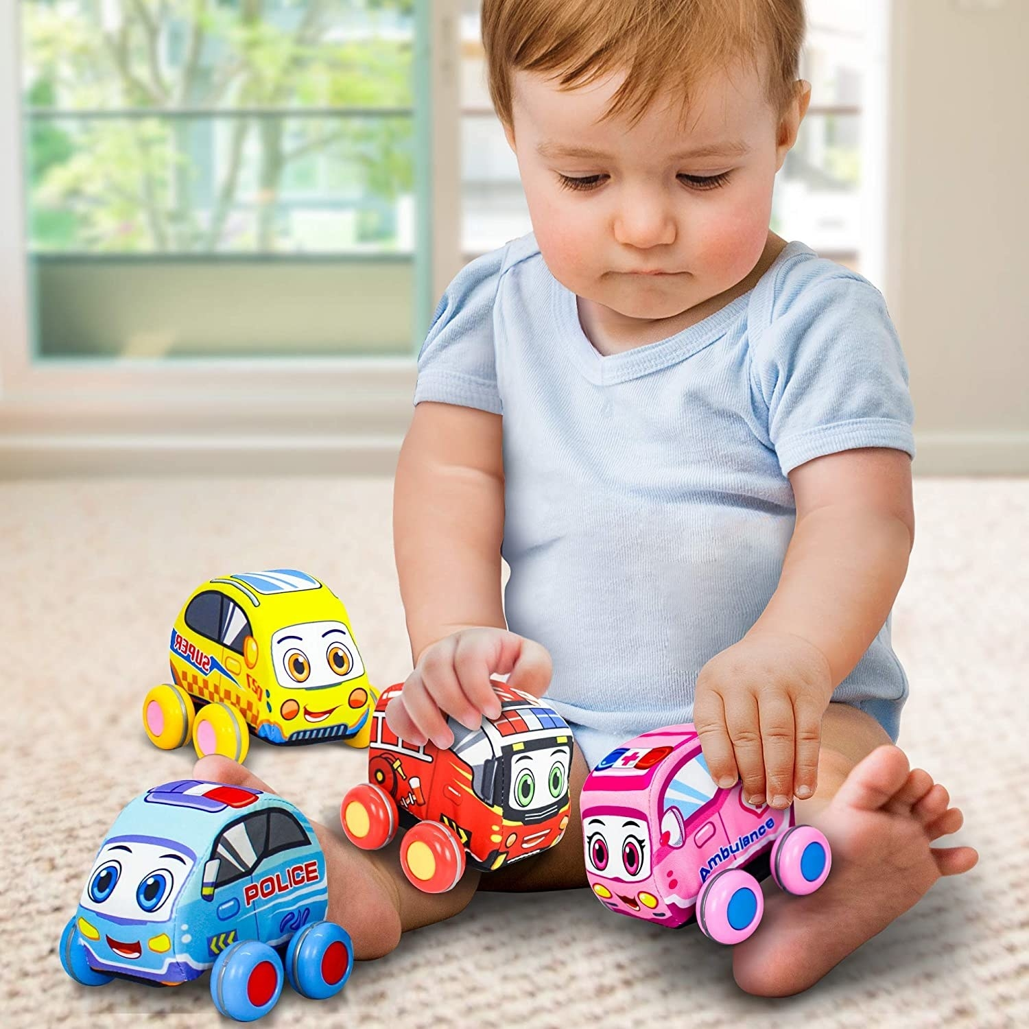 a child playing with the four different plush cars