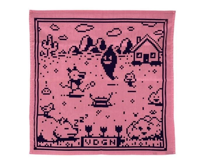 pink bandana with little video game critters on a field with a cactus and a house in the background. the bottom says VDGN
