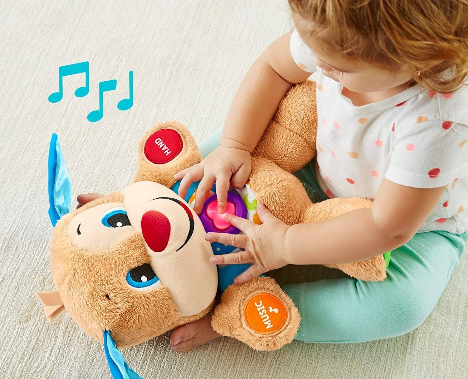 a child squeezing the light up heart on the plush puppy