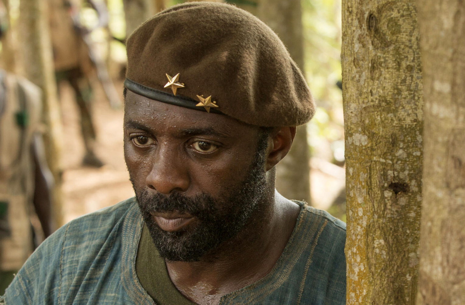 Idris Elba sweating and looking worried in Beasts of No Nation