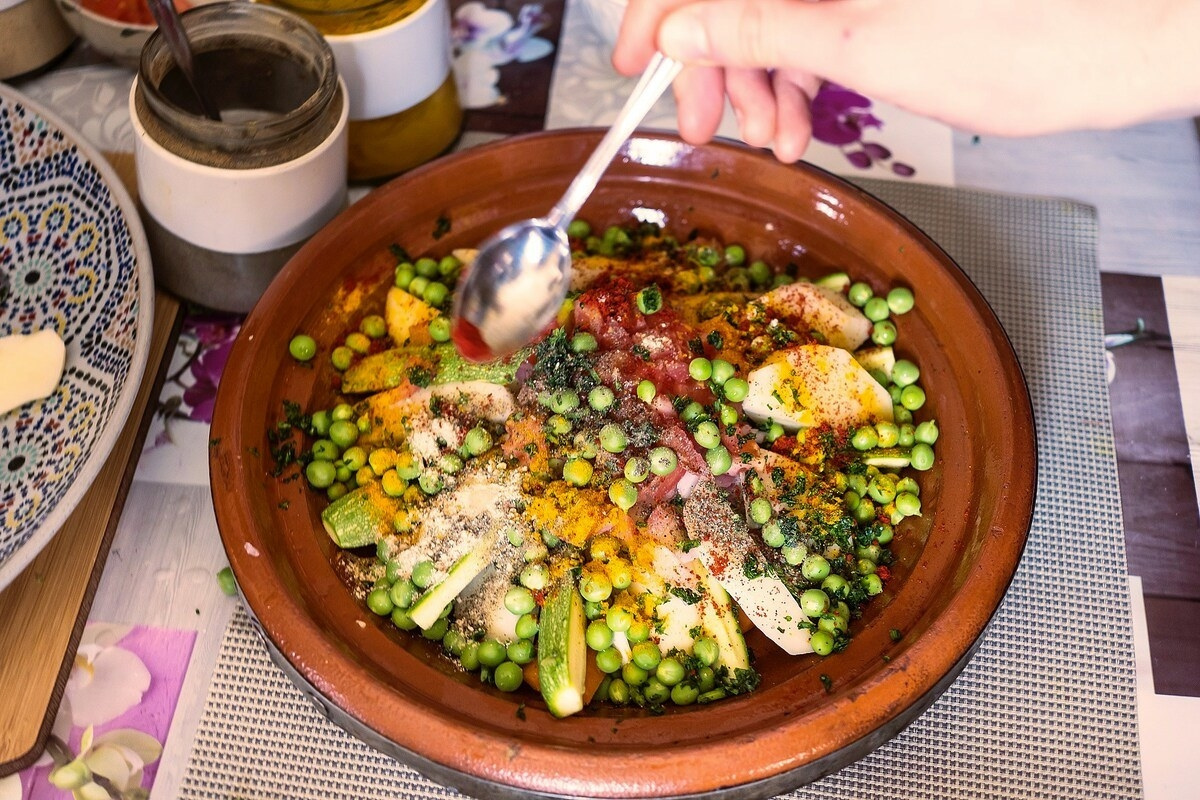 chicken and vegetable tajine being prepared