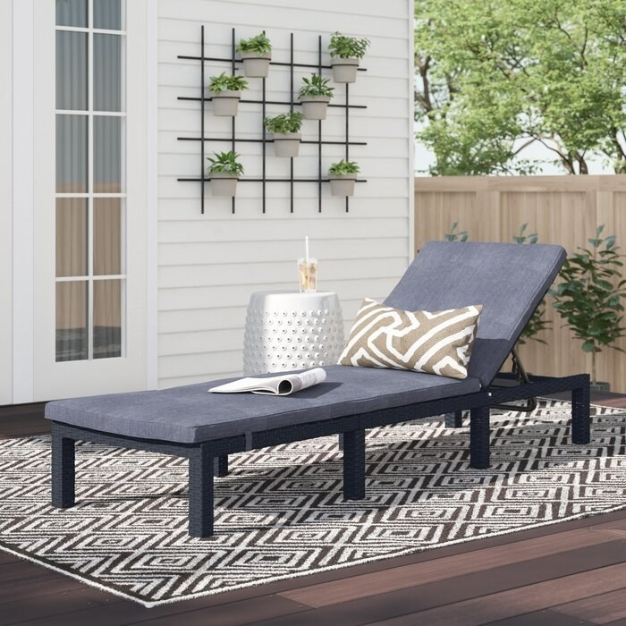 Outdoor chaise with a gray cushion