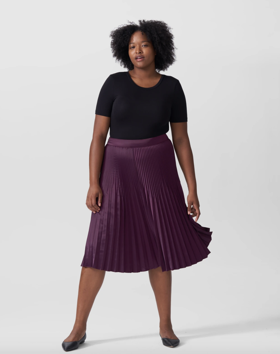 Model wearing the skirt in purple