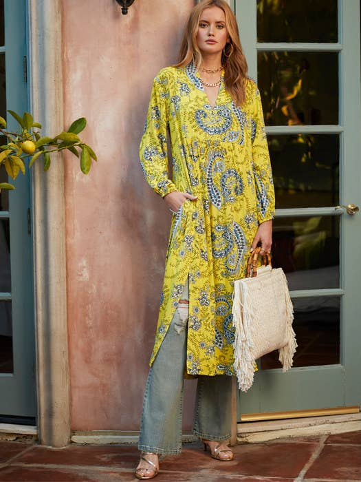 Model wearing the paisley dress in yellow