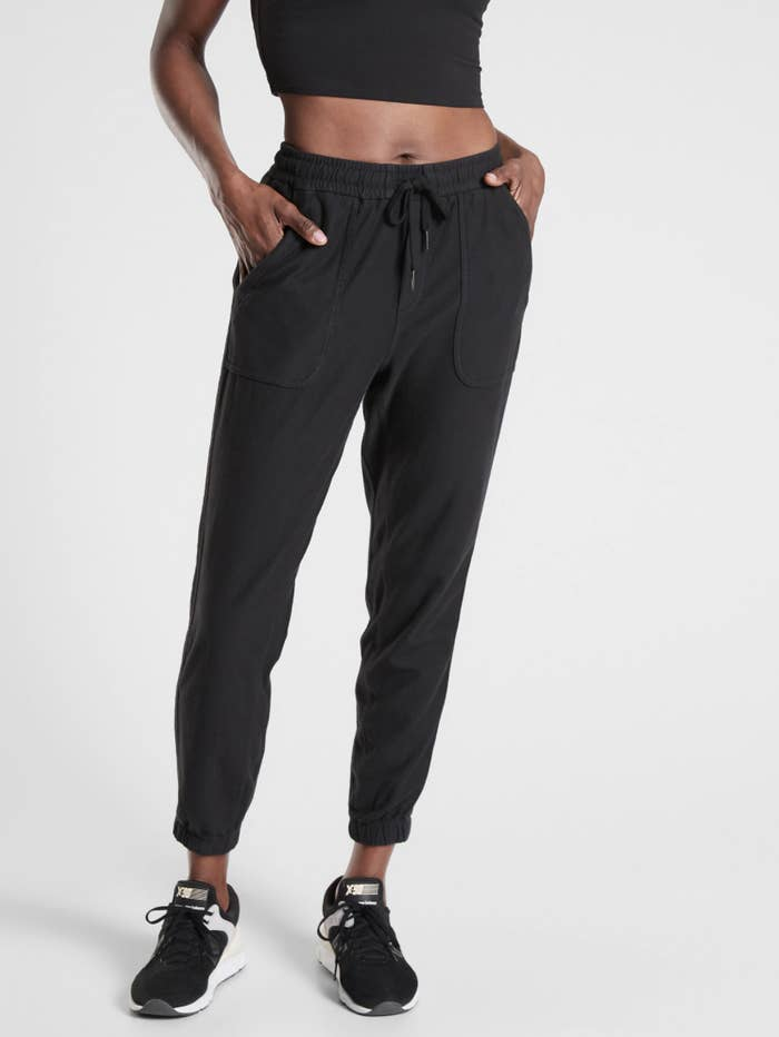 A model wearing the joggers, which gather at the ankles and have a drawstring waist