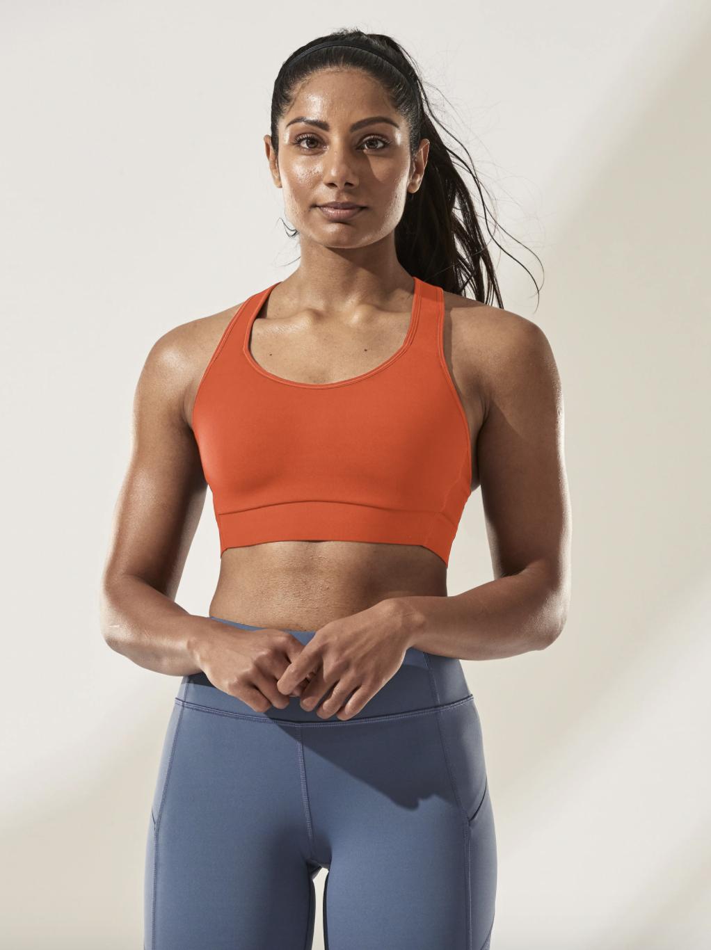 A model wearing the basic looking u-neck sports bra