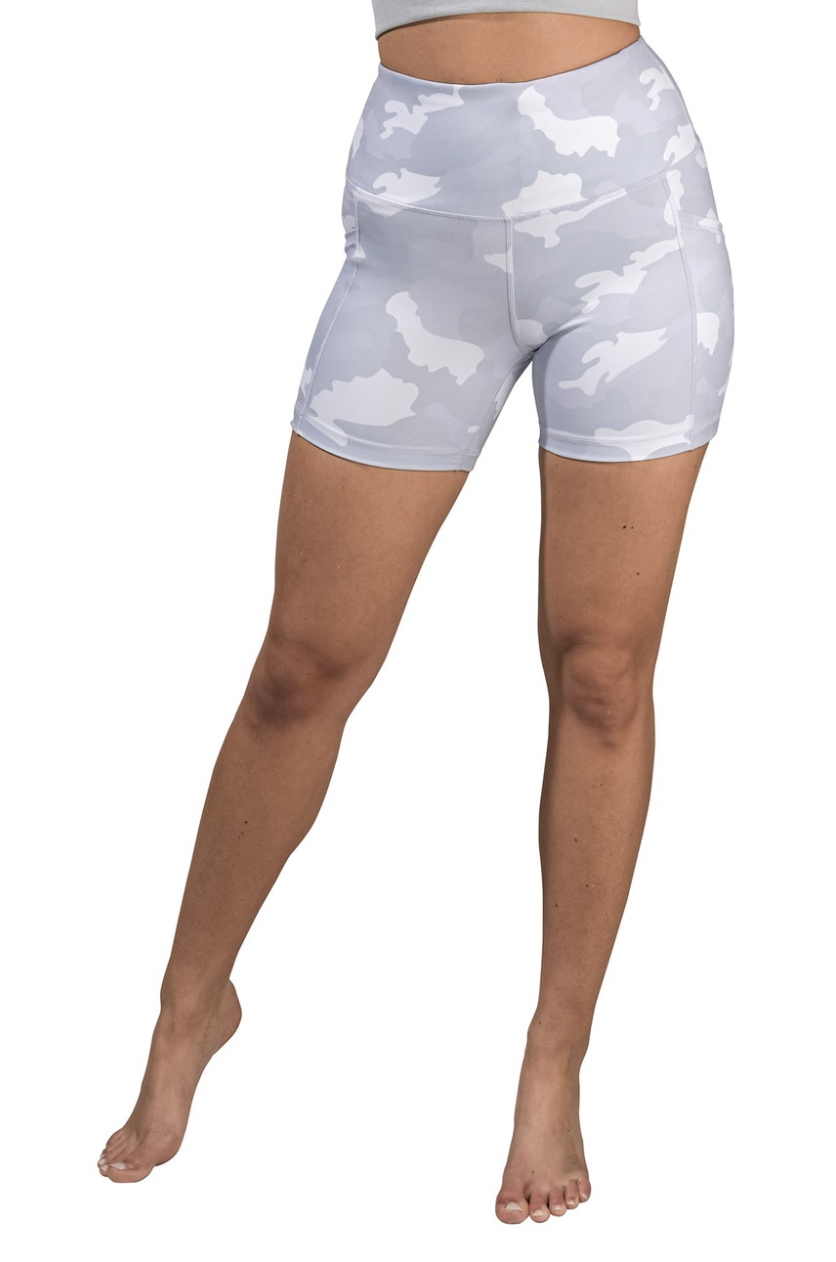 A model in pale blue and white camo print bikes shorts that fall mid-thigh