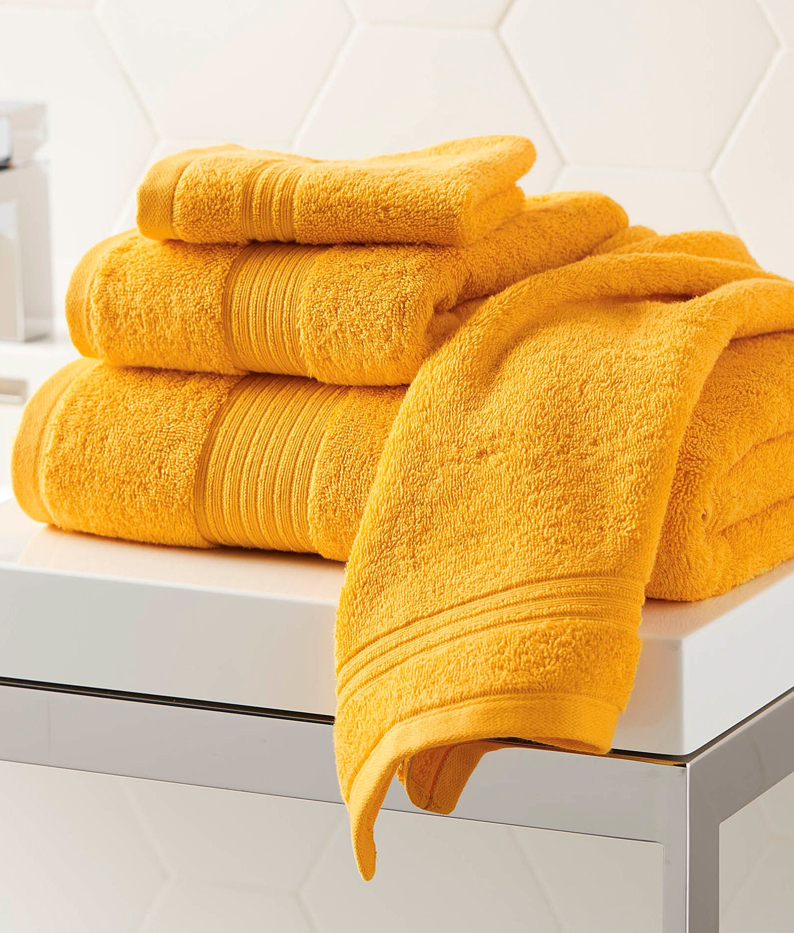 Four towels folded on top of each other
