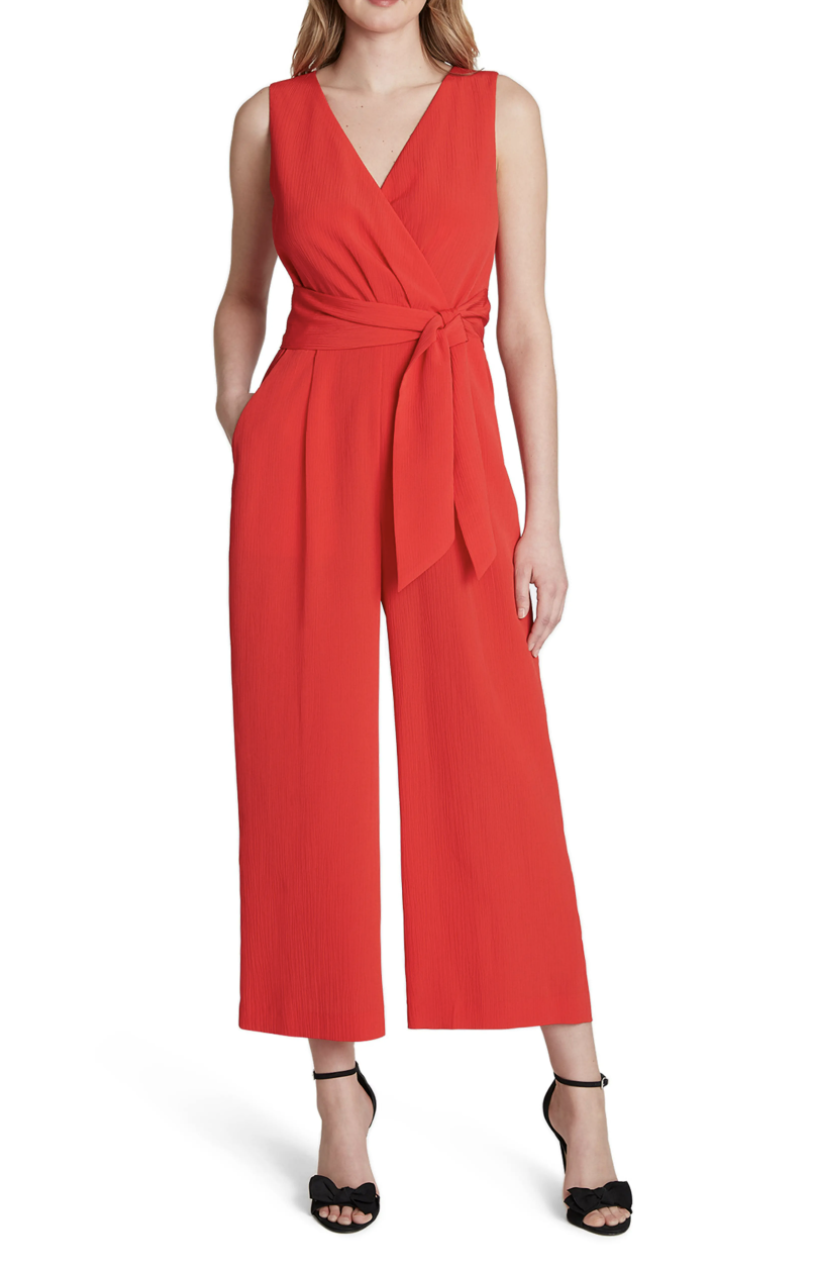 The jumpsuit in red with wide legs and a v-neck