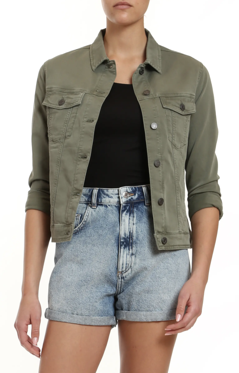 Model wearing the jacket with silver buttons down the front and two pockets with buttons in green