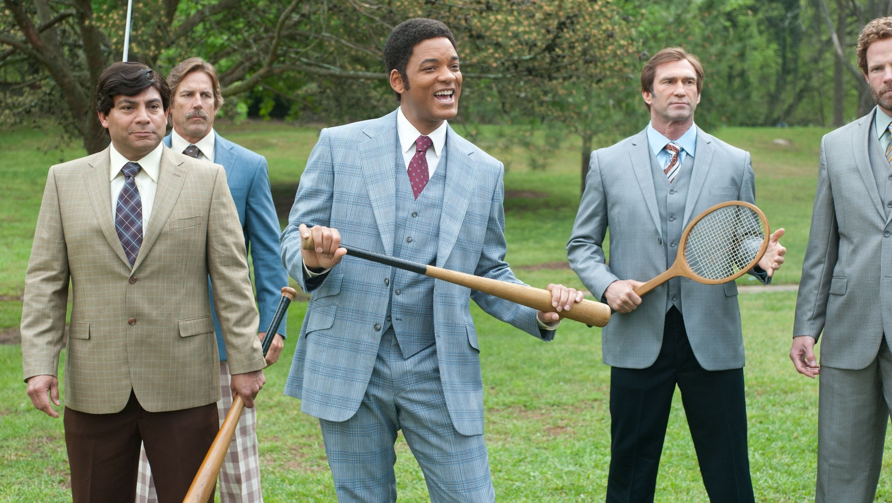 Will Smith holds a baseball bat as an anchorman ready to rumble with other anchors