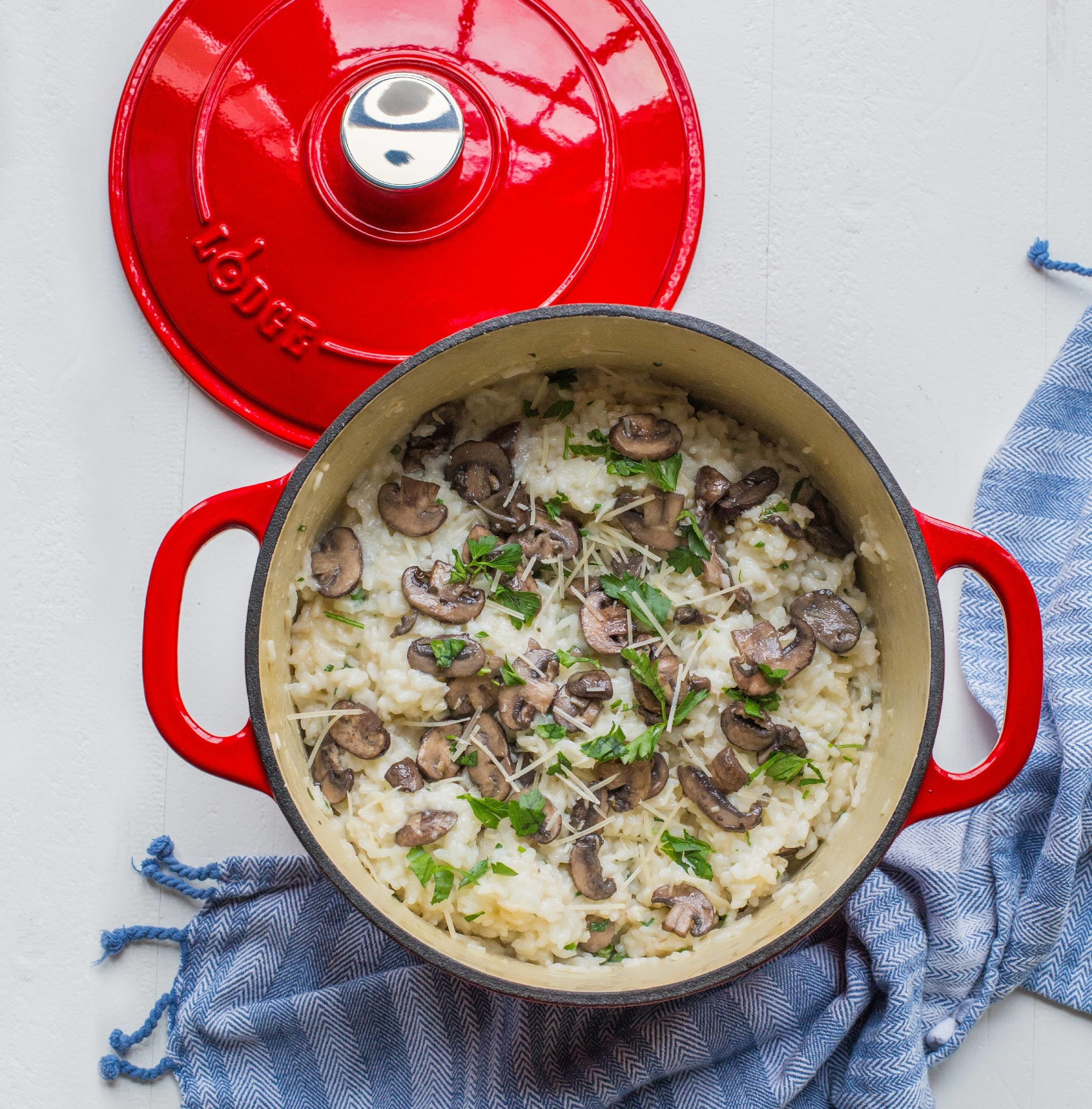 The red dutch oven cooking a rice dish