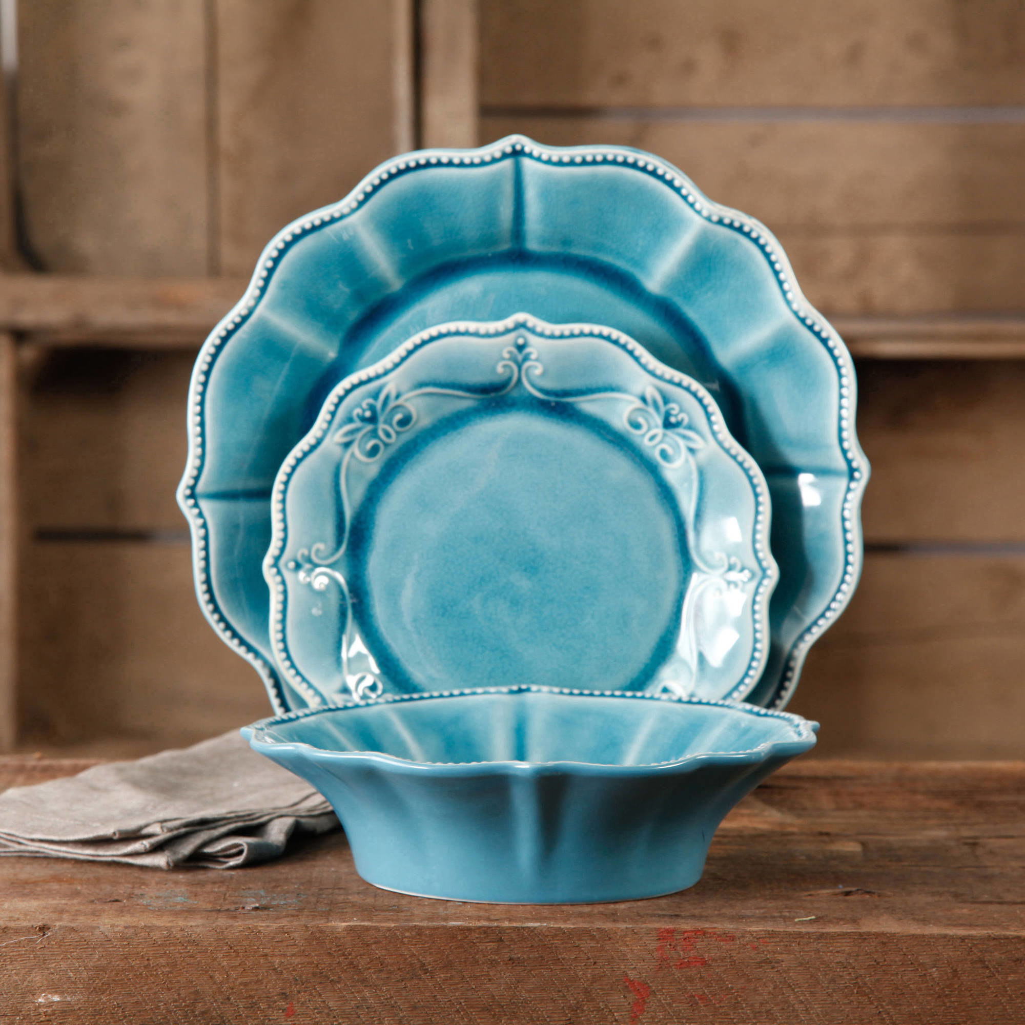 The blue dish set with scalloped edges