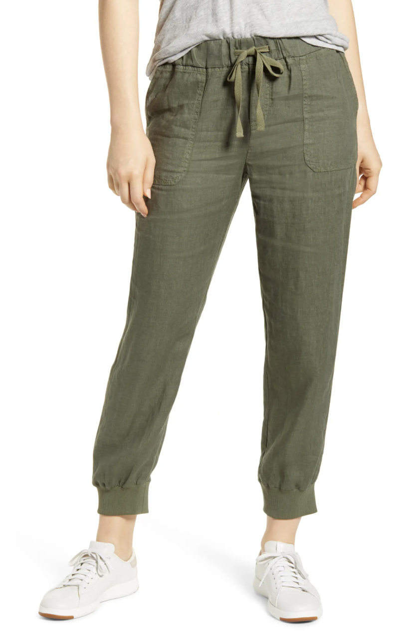 The joggers in green with front patch pockets, ribbed cuffs, and an elasticized drawstring waist