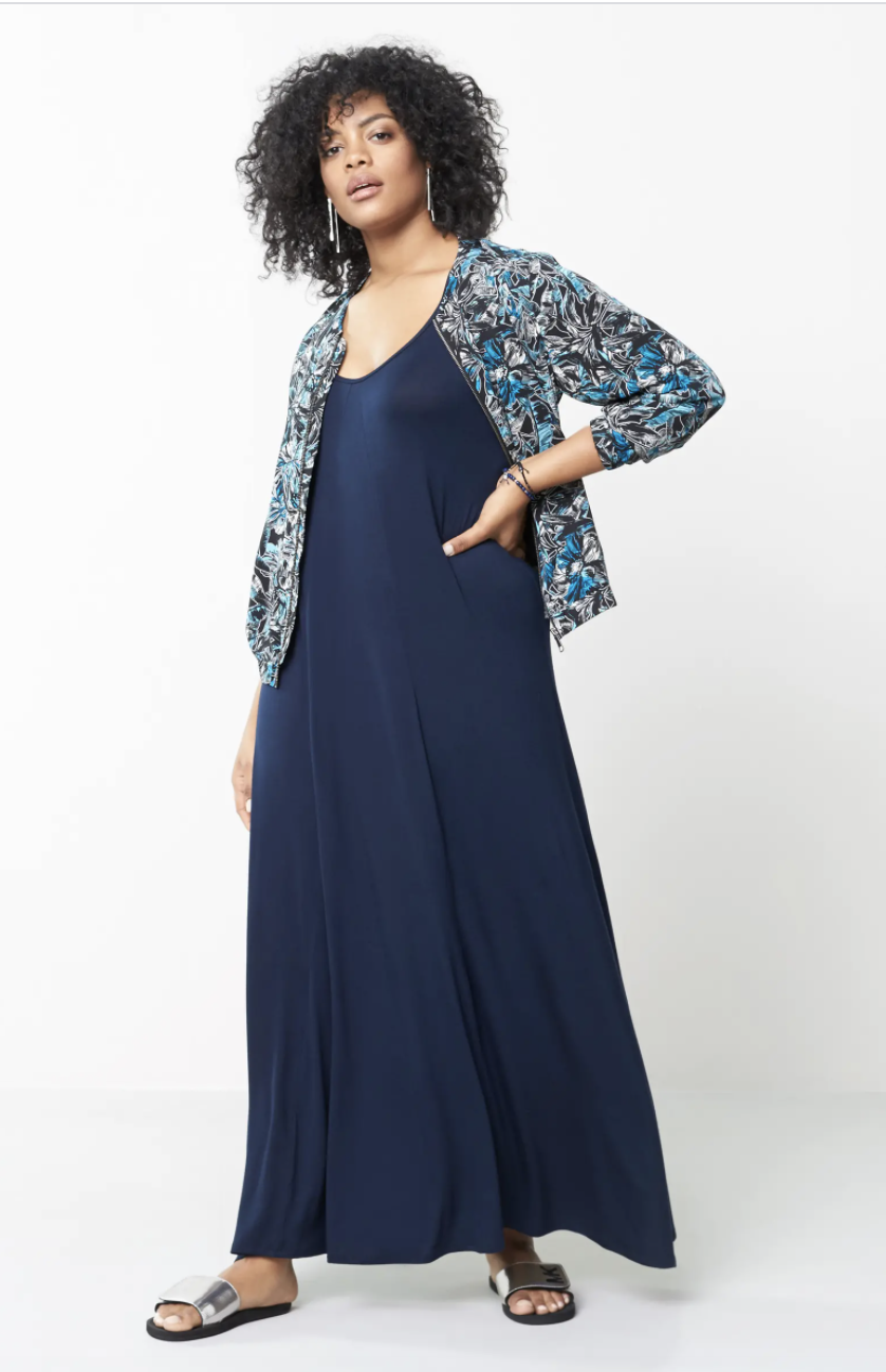 Model wearing the scoop-neck a-line maxi with spaghetti straps in navy blue